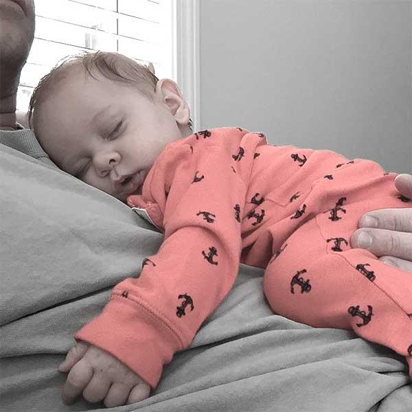 Baby asleep on dad
