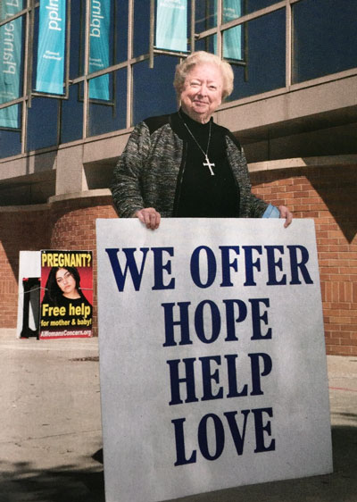 Eleanor McCullen holding sign